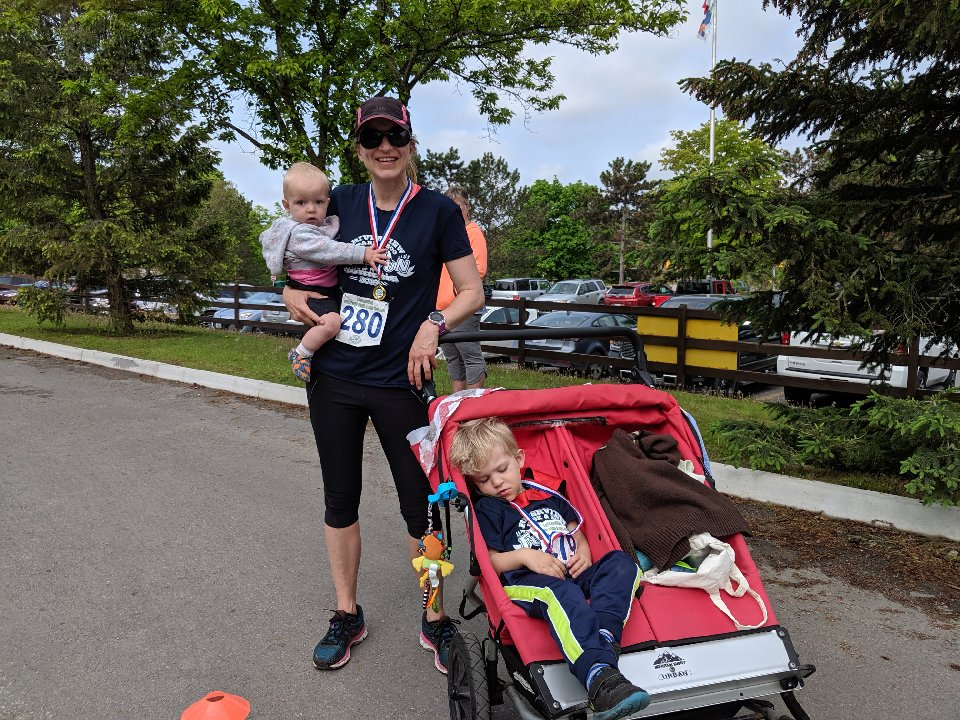 Mom with stroller and kids in 10th annual fun run