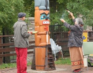 First Nations people rededicating the totem pole