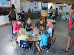 kids and adults going through the conservation exhibit displays and making crafts